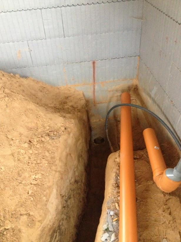 Kanalizacijos išėjimas per pamatą